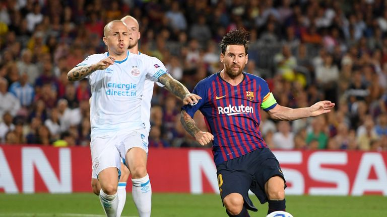Lionel Messi scores his third goal during the Group B match of the UEFA Champions League between FC Barcelona and PSV at Camp Nou on September 18, 2018 in Barcelona, Spain.
