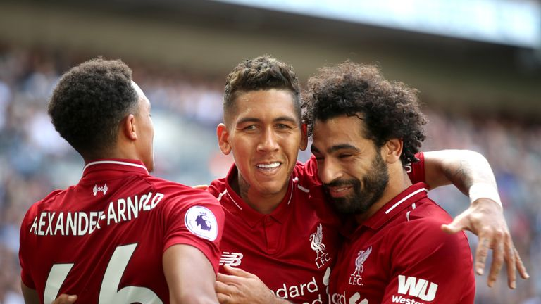 Roberto Firmino (C) celebrates scoring against Tottenham