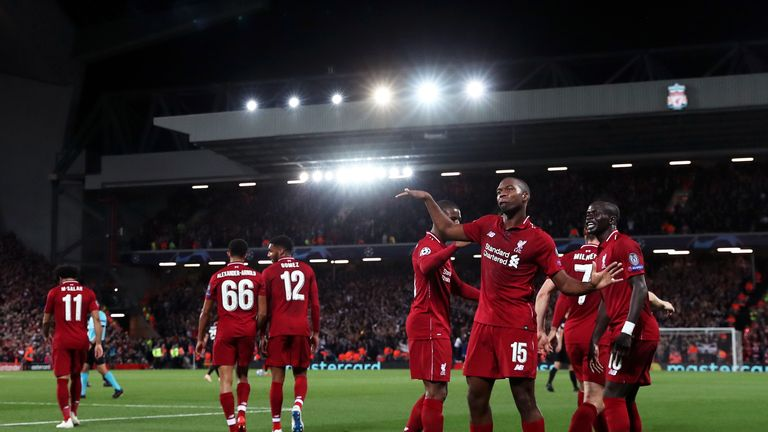 Daniel Sturridge of Liverpool celebrates after scoring his team's first goal during the Group C match of the UEFA Champions League between Liverpool and Paris Saint-Germain at Anfield on September 18, 2018 in Liverpool, United Kingdom