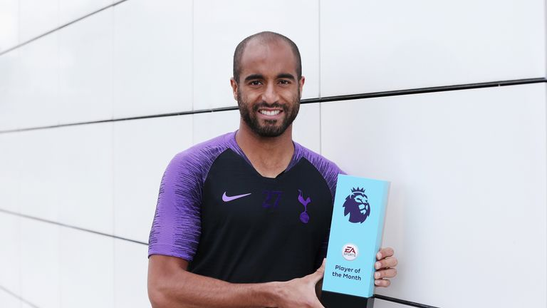 Lucas Moura poses with his award at Tottenham Hotspur's Training Centre