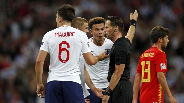 England players complain after Danny Welbeck's goal is ruled out against Spain