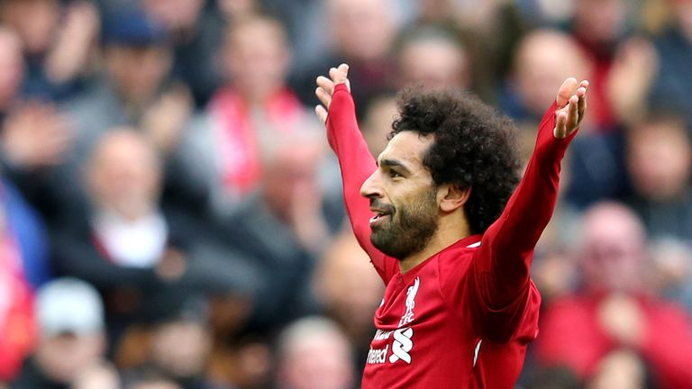 Mohamed Salah celebrates after scoring Liverpool's third goal