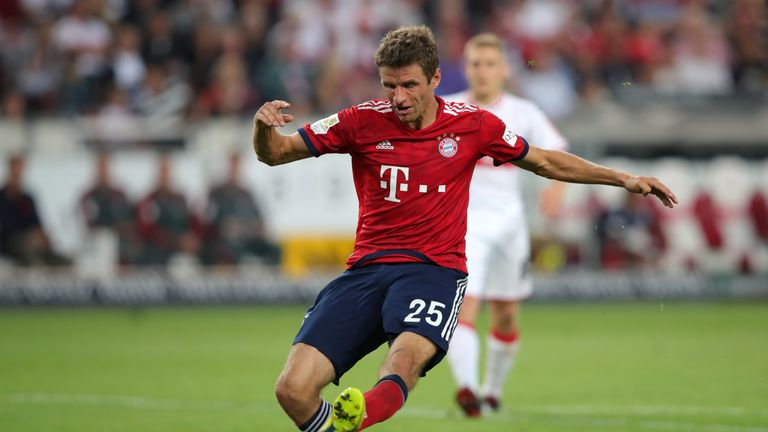 Thomas Muller strokes in Bayern's third at the Mercedes-Benz Area