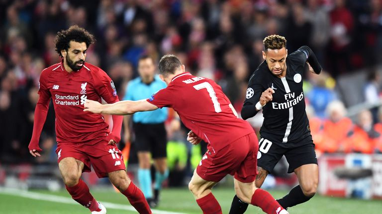 Neymar is challenged by James Milner during Liverpool's 3-2 home win over PSG