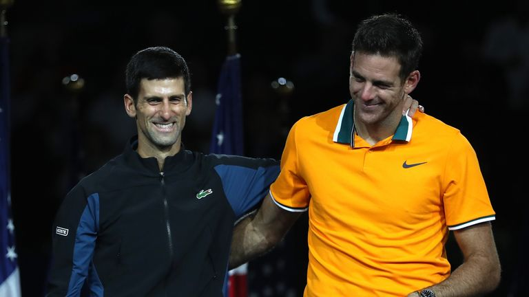 Juan Martin del Potro (R) believes Novak Djokovic can catch Roger Federer's mark of 20 Grand Slams