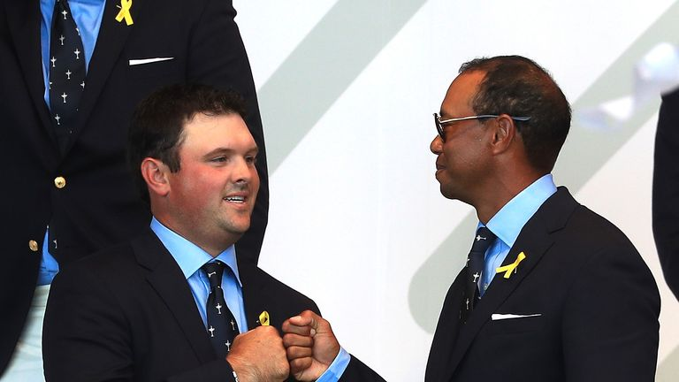 Patrick Reed and Tiger Woods fist bump as their fourball pairing is announced