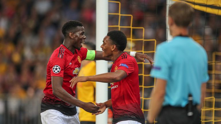 Paul Pogba celebrates with Anthony Martial