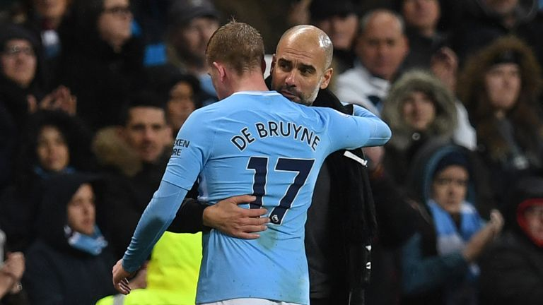 Manchester City's Spanish manager Pep Guardiola (R) embraces Manchester City's Belgian midfielder Kevin De Bruyne as he is substituted during the English Premier League football match between Manchester City and Watford at the Etihad Stadium in Manchester, north west England, on January 2, 2018.