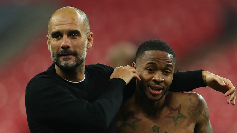 Josep Guardiola, Manager of Manchester City celebrates victory with Raheem Sterling of Manchester City after the Premier League match between Tottenham Hotspur and Manchester City at Wembley Stadium on April 14, 2018 in London, England.