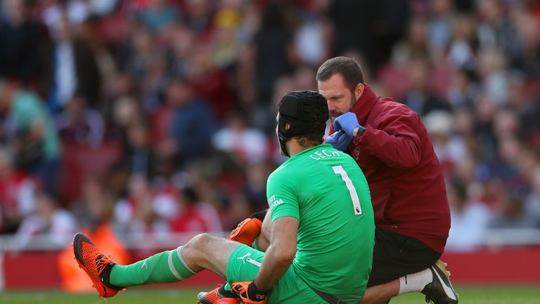 Petr Cech receives treatment prior to being substituted in Arsenal's victory over Watford on Saturday