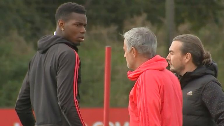 Paul Pogba and Jose Mourinho exchange words during training.