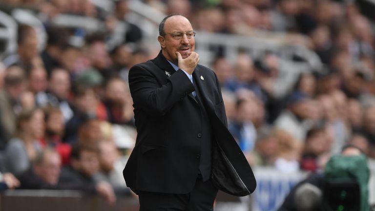 Rafa Benitez on touchline scratching his chin thoughtfully