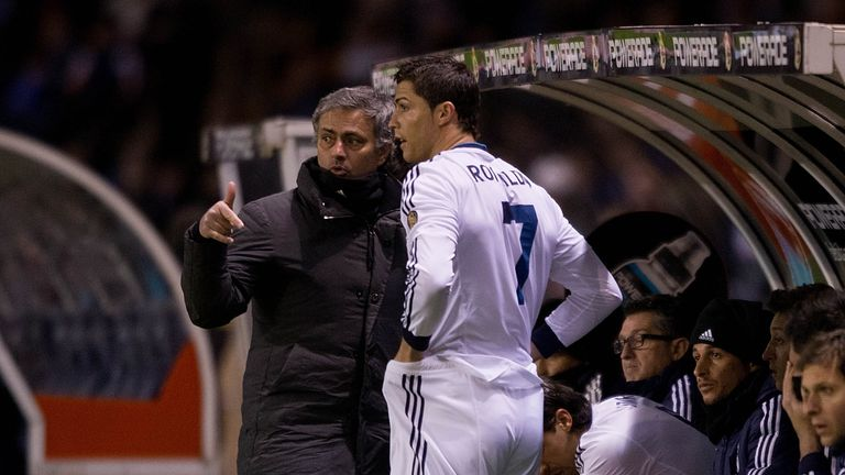 Head coach Jose Mourinho (L) of Real Madrid CF gives instructions to Cristiano Ronaldo (2ndl) on the desk during the La Liga match between RC Deportivo La Coruna and Real Madrid CF at Riazor Stadium on February 23, 2013 in La Coruna, Spain