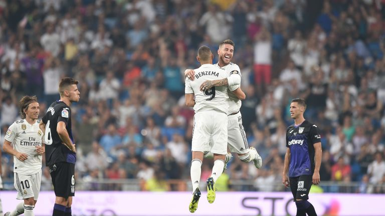 Karim Benzema celebrates with Sergio Ramos after scoring Real Madrid's second goal against Leganes