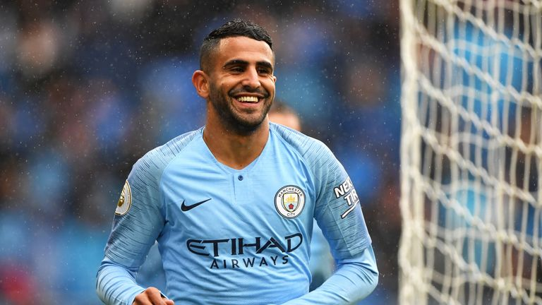 Riyad Mahrez celebrates after extending Manchester City's lead