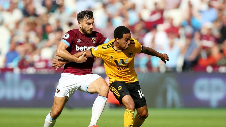 Robert Snodgrass and Helder Costa battle for the ball