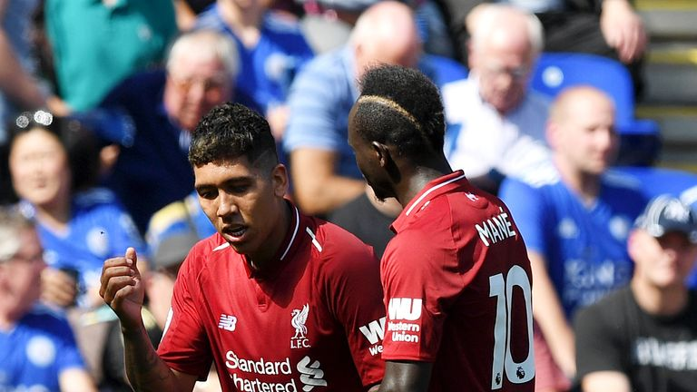 Roberto Firmino (left) celebrates after doubling his side's lead at the King Power
