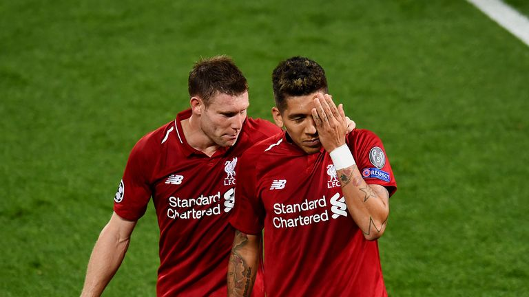 Roberto Firmino celebrates after scoring against PSG by covering the eye he injured against Tottenham