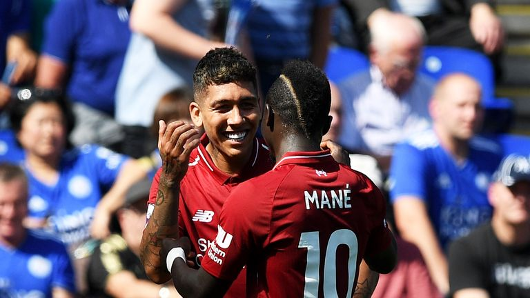 Roberto Firmino celebrates with Sadio Mane after doubling Liverpool's lead