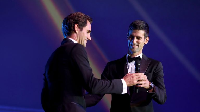 Team Europe Roger Federer of Switzerland hugs Team Europe Novak Djokovic of Serbia on stage during the Laver Cup Gala at the Navy Pier Ballroom on September 20, 2018 in Chicago, Illinois.