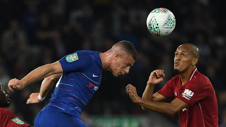 Chelsea's English midfielder Ross Barkley (L) vies with Liverpool's Brazilian midfielder Fabinho during the English League Cup third round football match between Liverpool and Chelsea at Anfield in Liverpool, north west England on September 26, 2018. (Photo by Paul ELLIS / AFP) / RESTRICTED TO EDITORIAL USE. No use with unauthorized audio, video, data, fixture lists, club/league logos or 'live' services. Online in-match use limited to 120 images. An additional 40 images may be used in extra time. No video emulation. Social media in-match use limited to 120 images. An additional 40 images may be used in extra time. No use in betting publications, games or single club/league/player publications. /         (Photo credit should read PAUL ELLIS/AFP/Getty Images)