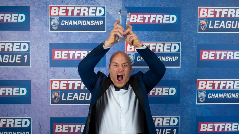 Broncos' head coach Danny Ward celebrating being named Championship Coach of the Year