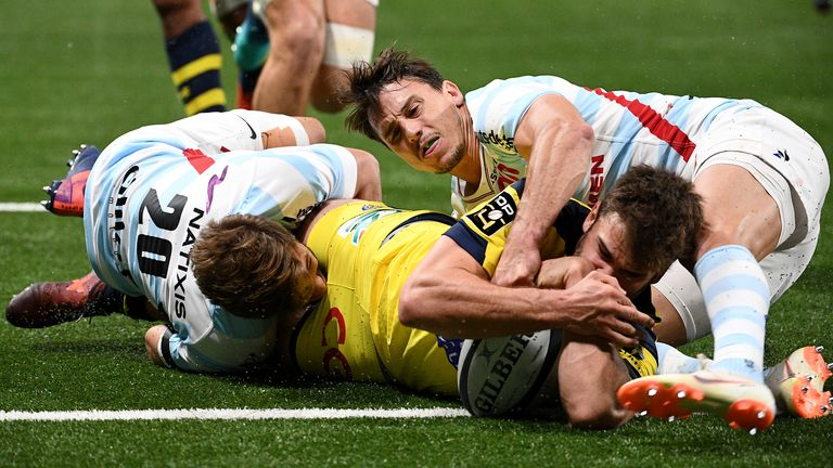 Clermont Auvergne's Damian Penaud crosses for a try against Top 14 rivals Racing 92