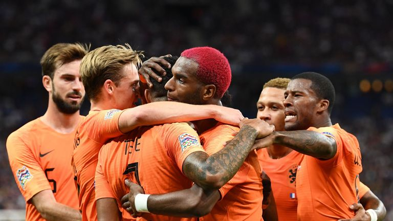 Ryan Babel celebrates with team-mates after drawing the Netherlands level against France