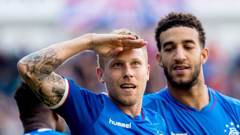 Scott Arfield celebrates his goal in Rangers' 5-1 win over St Johnstone, one of his six goal  sin all competitions this campaign
