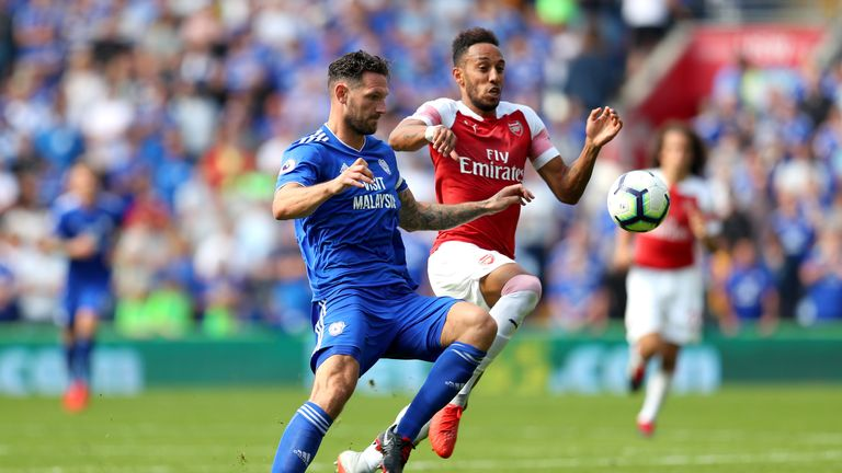 Sean Morrison battles for possession with Pierre-Emerick Aubameyang