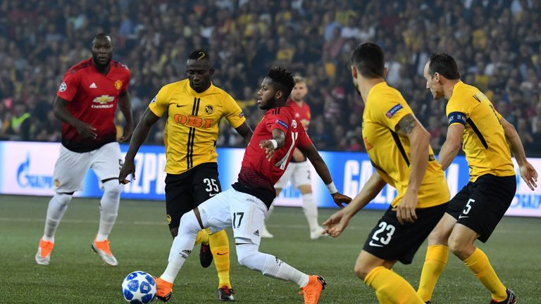 Sekou Sanogo looks to slip past Fred in midfield