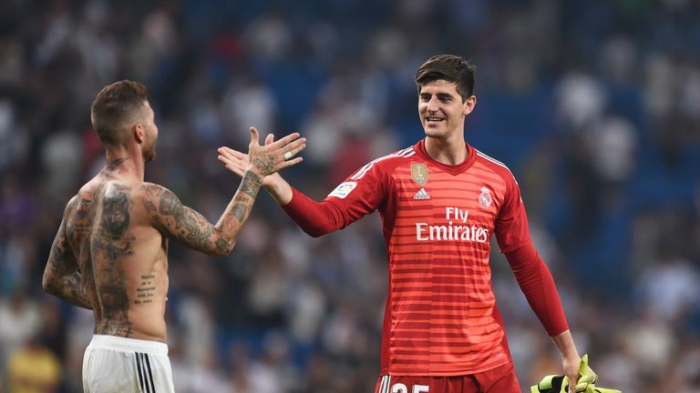 Thibaut Courtois is congratulated by Sergio Ramos after making his Real Madrid against Leganes