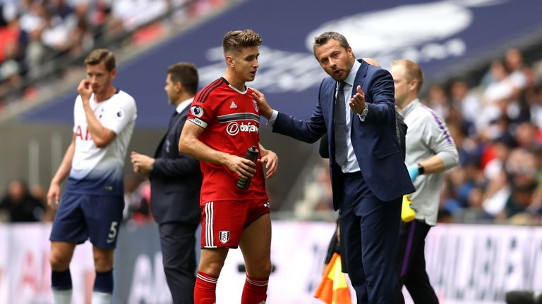 Tom Cairney receives instructions from manager Slavisa Jokanovic