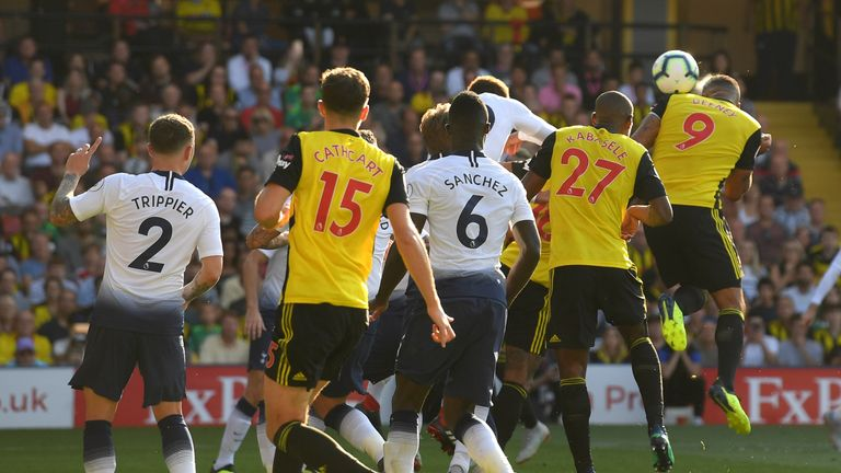 Troy Deeney of Watford (9) scores his team's first goal during the Premier League match between Watford FC and Tottenham Hotspur at Vicarage Road on September 2, 2018 in Watford, United Kingdom