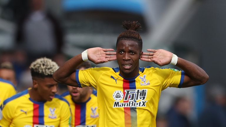 Wilfried Zaha celebrates scoring against Huddersfield