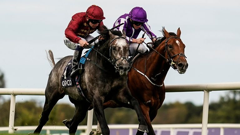 Oisin Murphy riding Roaring LIon (L, red) win the QIPCO Irish Champion Stakes from Ryan Moore and Saxon Warrior