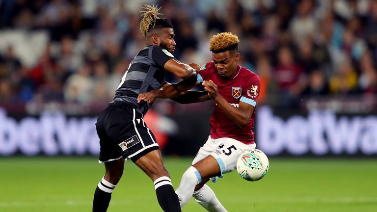 Tyrone Marsh battles for possession with Grady Diangana