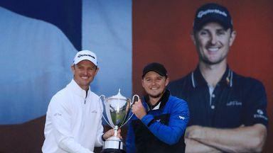 Eddie Pepperell holds his Sunshine Golf British Masters trophy alongside tournament host Justin Rose