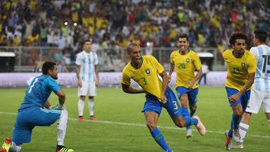 Miranda (centre) celebrates his dramatic late winner for Brazil