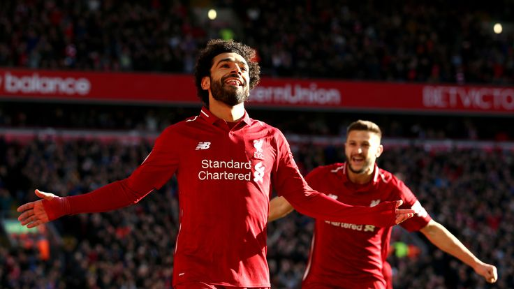 Mohamed Salah celebrates after putting Liverpool 1-0 up against Cardiff City