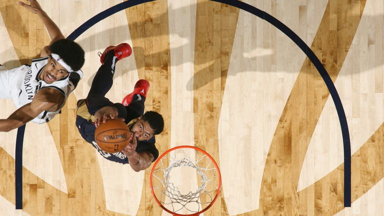 Anthony Davis hauls down a rebound against the Brooklyn Nets