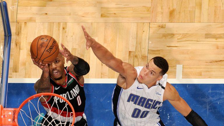 Damian Lillard attacks the basket against the Orlando Magic