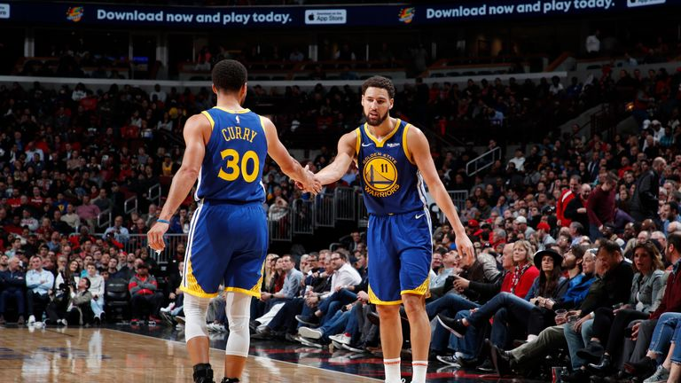 Klay Thompson is congratulated by team-mate Steph Curry