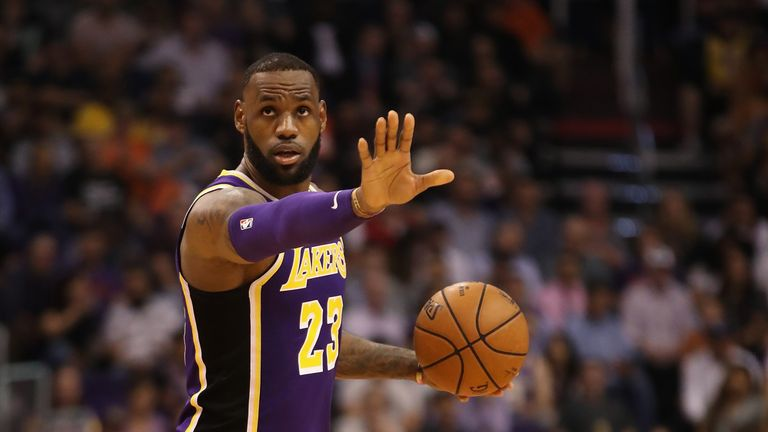 LeBron James led the Los Angeles Lakers to their first victory of the season