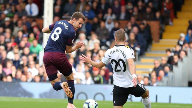 Aaron Ramsey scores Arsenal's third goal with a backheel into the far corner