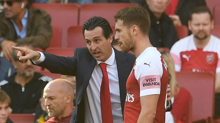 Aaron Ramsey of Arsenal gets instructions from Arsenal Head Coach Unai Emery during the Premier League match between Arsenal FC and Watford FC at Emirates Stadium on September 29, 2018 in London, United Kingdom.