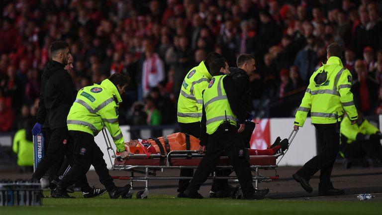 Aberdeen's Andrew Considine is stretchered off