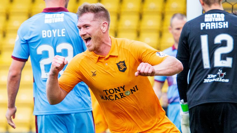 Livingston's Alan Lithgow celebrates after making it 4-0