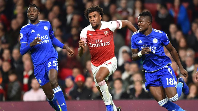 Alex Iwobi takes on Daniel Amartey