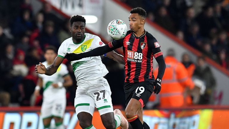 Alexander Tettey (L) vies with Bournemouth midfielder Junior Stanislas during the Carabao Cup fourth-round match between Bournemouth and Norwich City